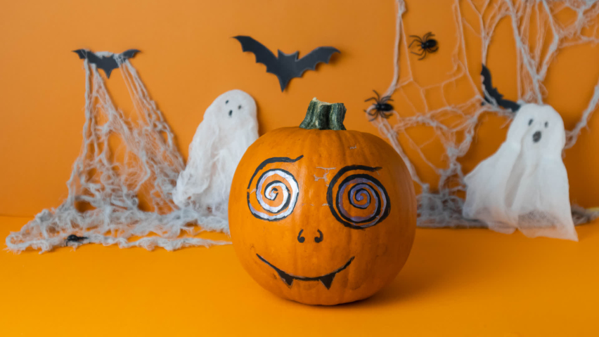 Painted pumpkin spins around itself and changes facial expression, stop motion video for halloween, happy halloween concept | Shutterstock HD Video #1059577682