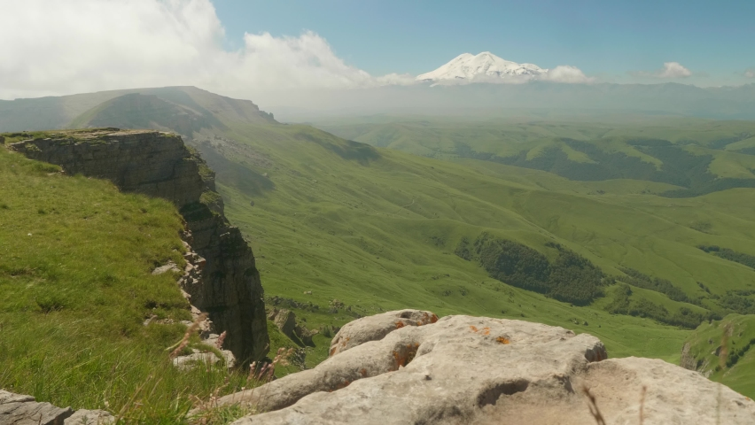 View of Elbrus from green plateau Bermamyth. Wild Russian nature | Shutterstock HD Video #1059578951