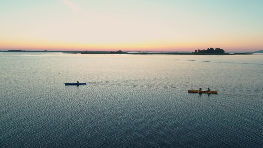 Aerial drone footage. Tourists are kayaking. Beautiful sunrise over river | Shutterstock HD Video #1059580790