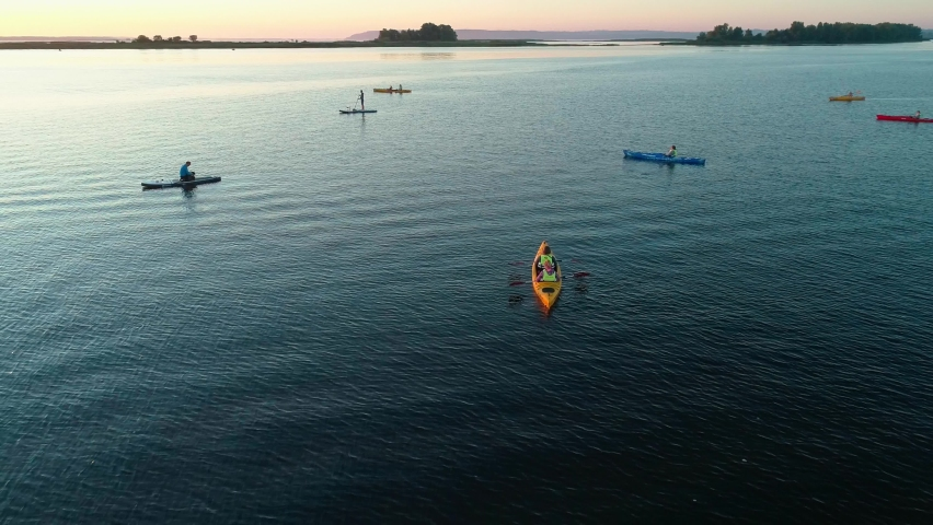 Aerial drone footage. A group of tourists are kayaking. Beautiful sunrise over river | Shutterstock HD Video #1059580793