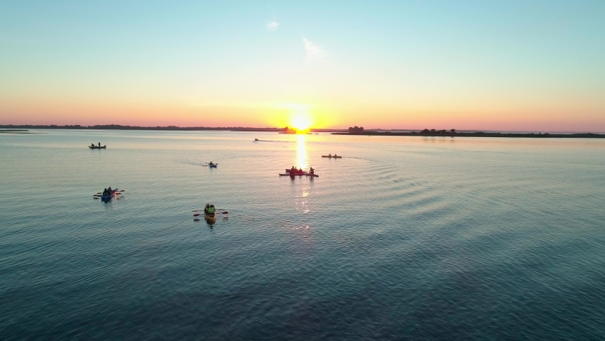 Aerial drone footage. A group of tourists are kayaking. Beautiful sunrise over river | Shutterstock HD Video #1059580799