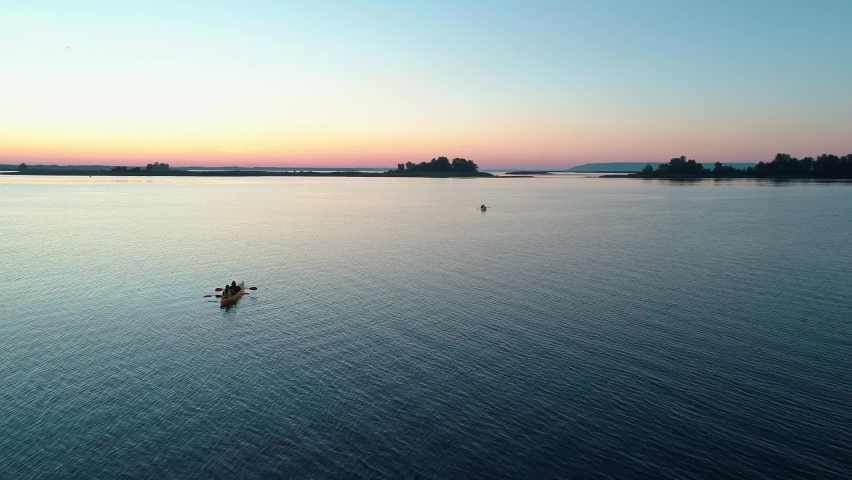 Aerial drone footage. Tourists are kayaking. Beautiful sunrise over river | Shutterstock HD Video #1059580802