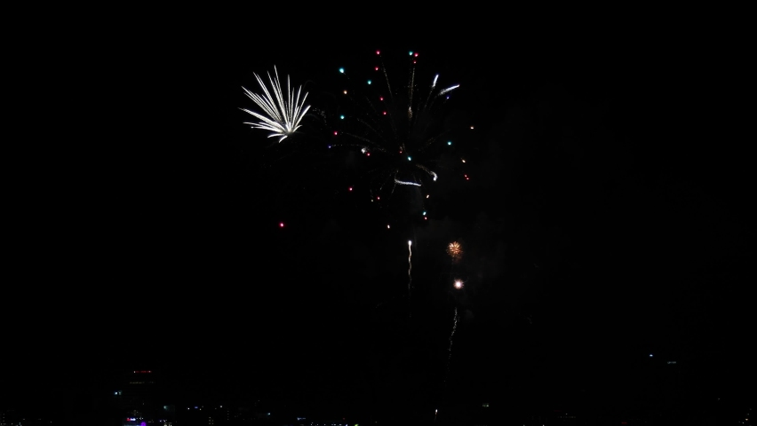 Celebration greeting Beautiful fireworks colorful fireworks on the beach for abstract background , anniversary, celebration , 4th independence day and new year background or wallpaper.  | Shutterstock HD Video #1059582248