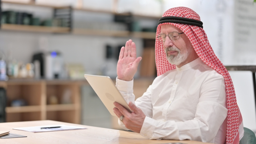 Old Arab Businessman Talking for Video Chat on Tablet