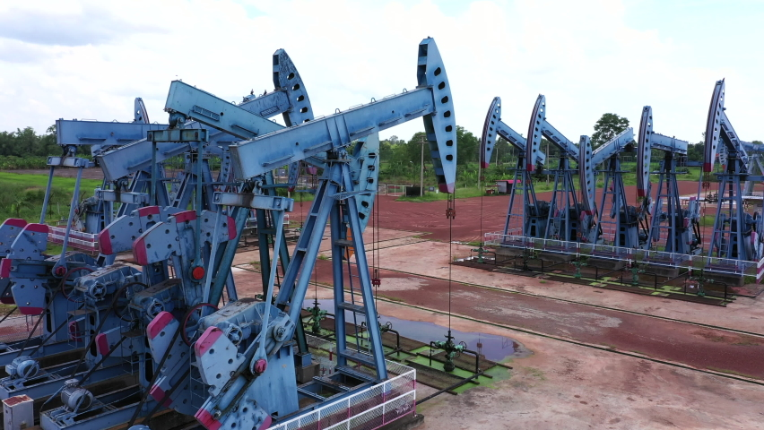Working Pumpjack industrial oil pump jack working and pumping crude oil for fossil fuel energy with drilling rig  | Shutterstock HD Video #1059586052