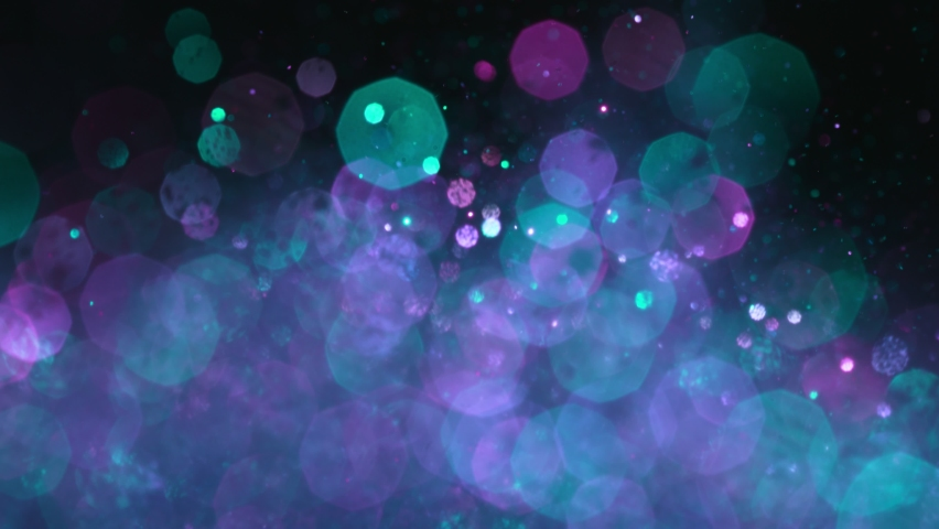 Super Slow Motion Shot of Neon Glitter Background at 1000fps. | Shutterstock HD Video #1059623924