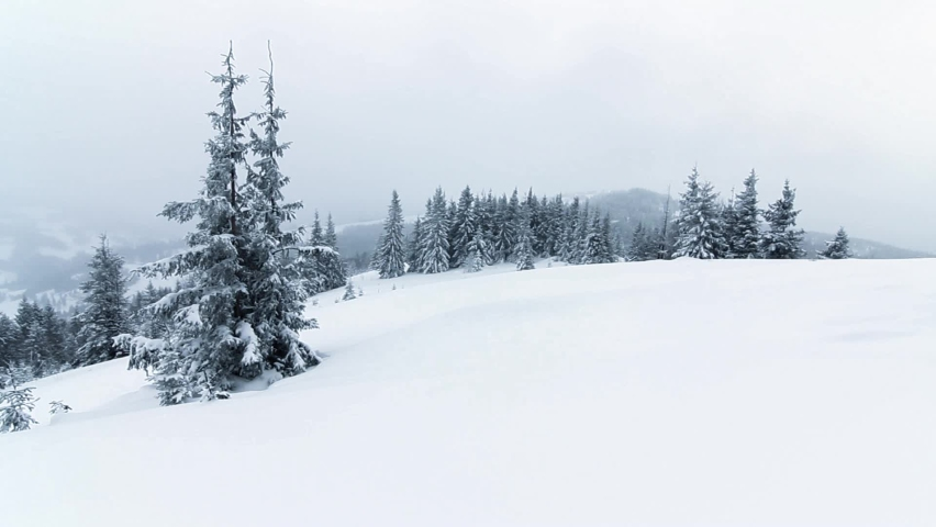 Beautiful winter landscape with snow covered trees. Winter mountains. | Shutterstock HD Video #1059626570