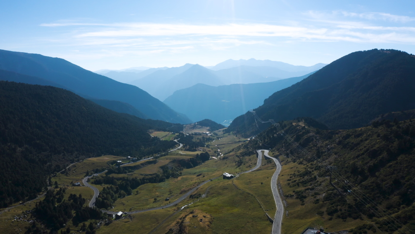 Aerial view of natural mountain valley with serpantine road, Encamp, Andorra