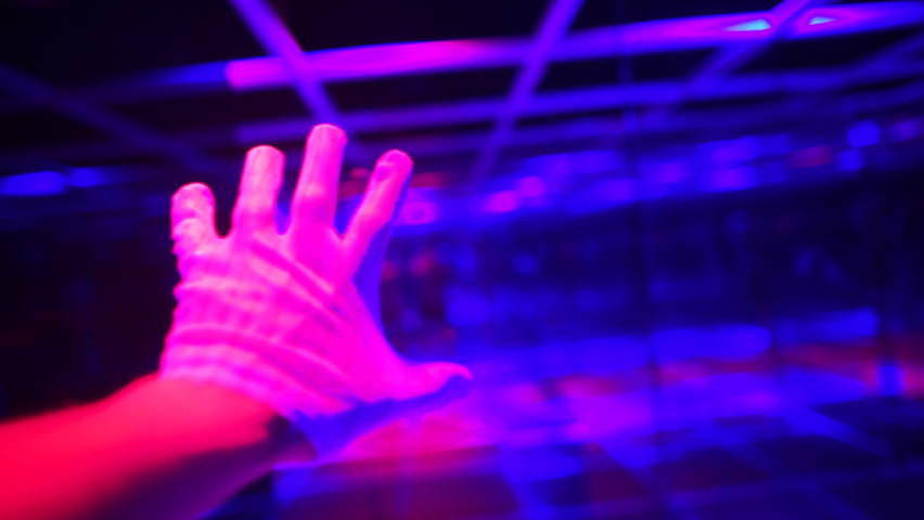 A hand in a white glove in a light glass labyrinth makes grasping movements like in computer first person view game. Imitation of virtual space in reality. View from eyes. | Shutterstock HD Video #1059634079