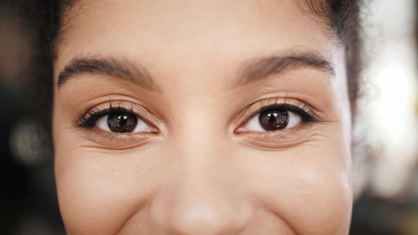Close up macro Eyes of a black woman, african american woman portrait, mix raced young female, student teenager generation z Royalty-Free Stock Footage #1059638672