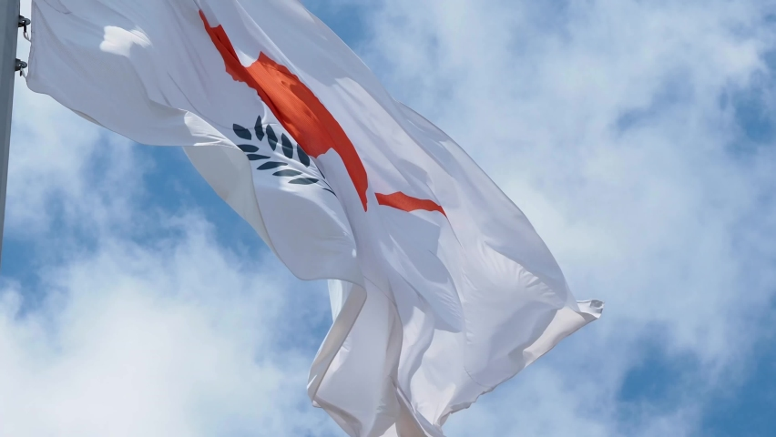 Cyprus flag fluttering in the wind. National flag against a blue sky, high flagpole #1059646496