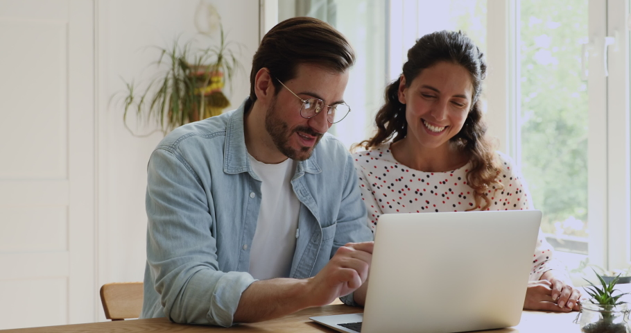 35s couple sit at desk using laptop enjoy online shopping together. Planning summer vacation booking hotel choose tour distantly by virtual commercial web services. Modern technology and fun concept Royalty-Free Stock Footage #1059665639