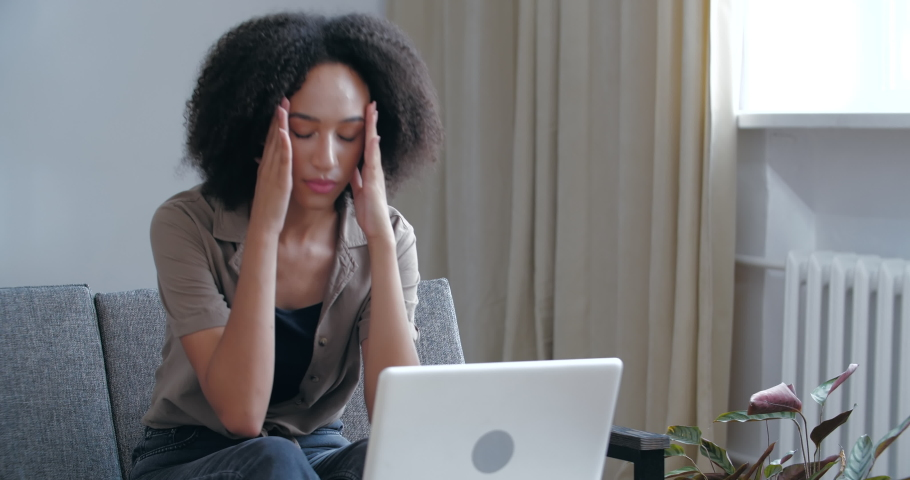 African American female in casual clothes reads letter results of medical tests, gets bad news, learns about virus disease, feels grief, sadness, desperately clutches head with her hands, pandemic time Royalty-Free Stock Footage #1059669686