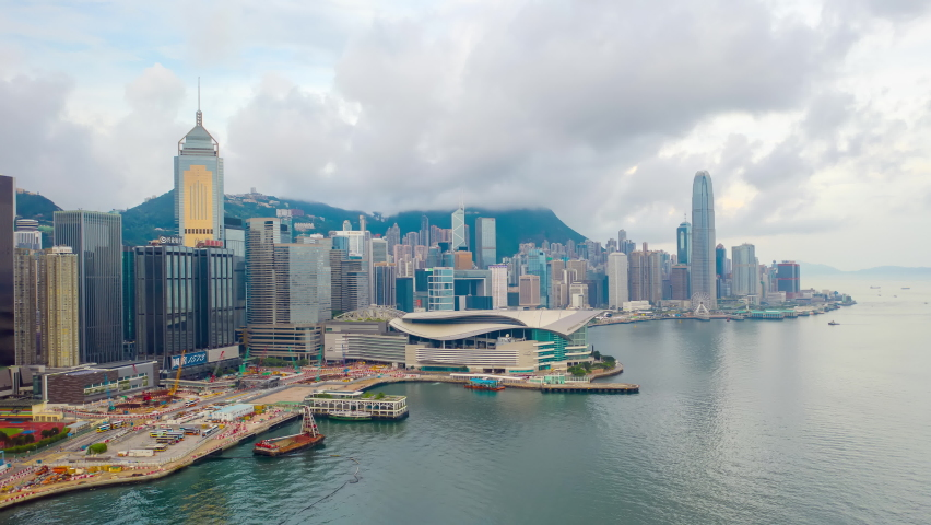 Aerial view hyperlapse 4k footage of Victoria Harbour in Hong Kong. hyper lapse in hong kong city. | Shutterstock HD Video #1059670871