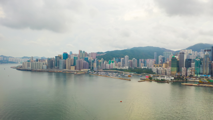 Aerial view hyperlapse 4k footage of Victoria Harbour in Hong Kong. hyper lapse in hong kong city. | Shutterstock HD Video #1059670874