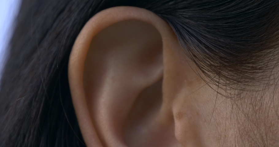 Close-up Female Ear. Outdoors Natural Lighting Morning Evening Time Royalty-Free Stock Footage #1059672518