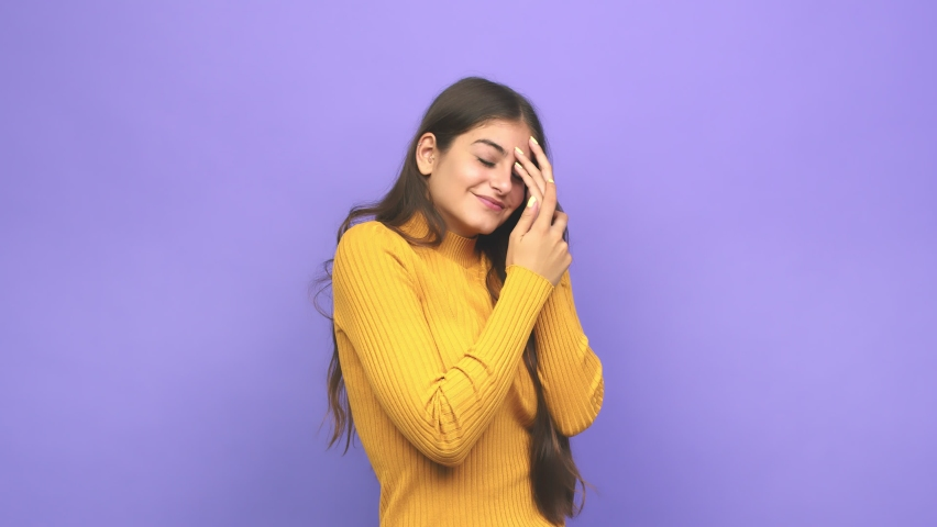 Young caucasian woman blink at the camera through fingers, embarrassed covering face | Shutterstock HD Video #1059675281