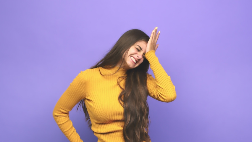 Young caucasian woman forgetting something, slapping forehead with palm and closing eyes | Shutterstock HD Video #1059675299