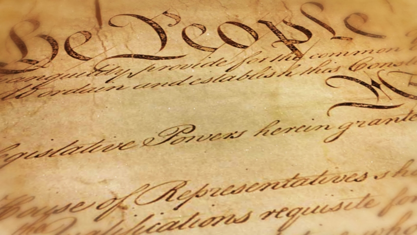 Socialist Agenda burning Constitution 4K Loop features the US Constitution scrolling by then stopping and beginning to burn with the words Socialist Agenda appearing from the dark in flames in a loop Royalty-Free Stock Footage #1059694973