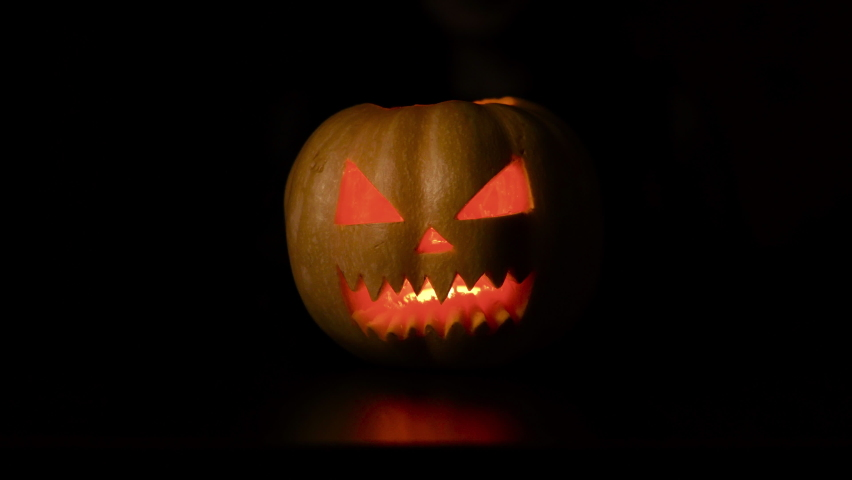 Isolated black background. The woman puts the pumpkin in the foreground. Halloween. Slowmotion   Shutterstock HD Video #1059697190