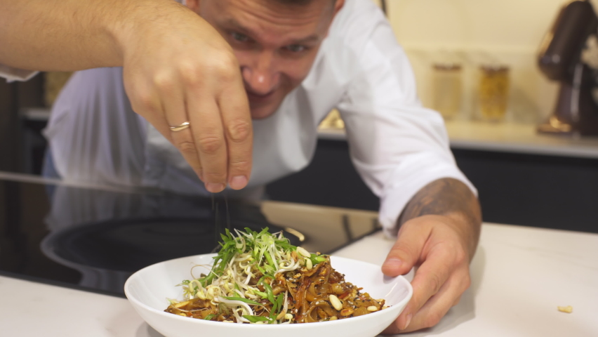 Professional Chef At Restaurant Kitchen Serves Dish On A Plate Adding Final Ingredients. Cooking Vegetarian Food At Modern Kitchen. Making Delicious Asian Food. Preparing Meal On Cuisine. Closeup. | Shutterstock HD Video #1059704207