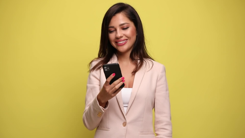 Young beautiful businesswoman talking on the phone, pointing at the camera and gesturing a call me sign against yellow background | Shutterstock HD Video #1059706976