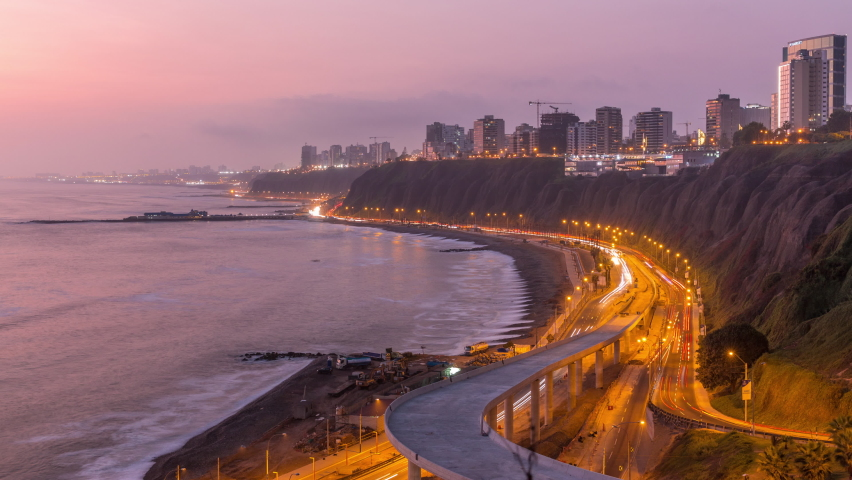 Aerial view of Lima's Coastline in the neighborhood of Miraflores day to night transition timelapse, Lima, Peru. Road traffic with junction and beach with ocean from Husares De Junin waterfront Royalty-Free Stock Footage #1059711416