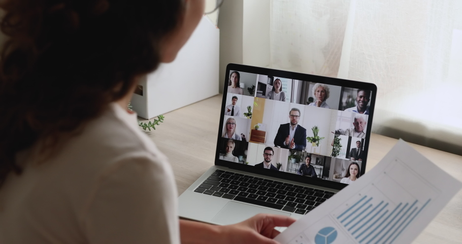 Woman lead virtual meeting with multi ethnic business partners. Team discuss project, financial stats of company brainstorm together at group briefing by videoconference, teamwork modern tech concept | Shutterstock HD Video #1059716336