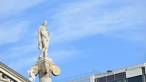 Athens, Greece. Time-lapse footage of ancient Greek god Apollo statue with blue sky and clouds passing by.4k resolution video.