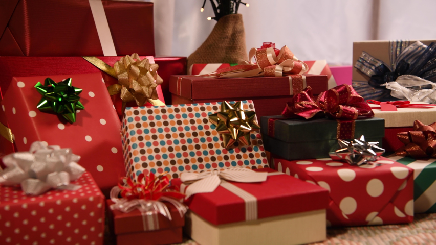 Holiday gifts under the christmas tree. | Shutterstock HD Video #1059725963
