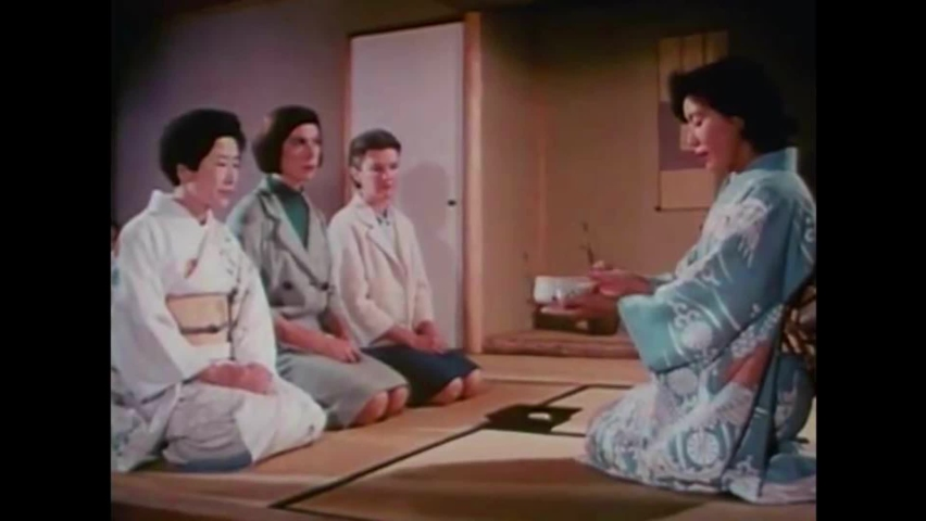 CIRCA 1960s - Two American women partake in a traditional Japanese tea ceremony at the 1964 New York World's Fair.