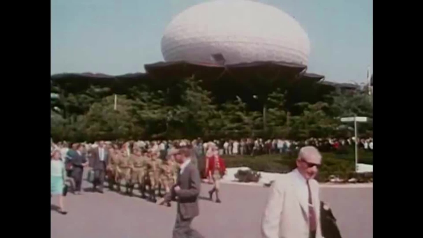 CIRCA 1960s - A troop of Boy Scouts marches around at the 1964 New York World's Fair, passing a Bell Telephone pavilion.