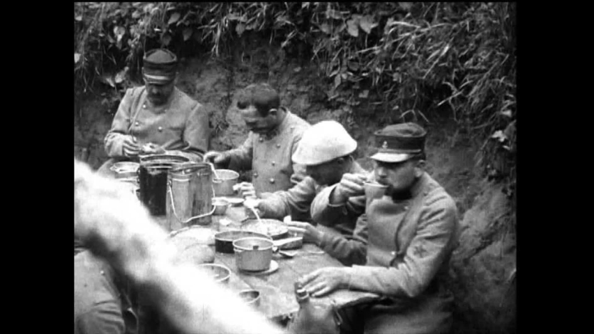 CIRCA 1910s - Soldiers in trenches eating, manning a telephone station and keeping watch are shown during World War 1, in 1917.