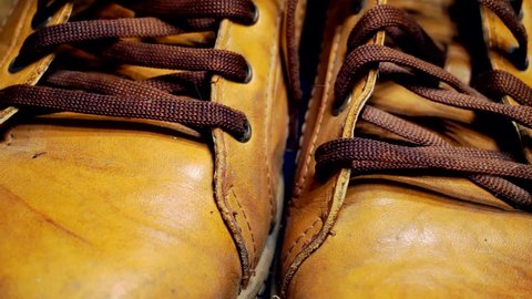 old rough stylish yellow mens leather shoes close up.