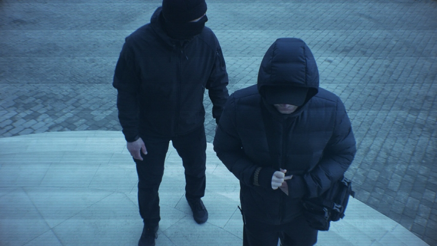 Video surveillance images. Two suspicious men stand at the door. Surveillance systems. Video broadcast. Recording. Thieves, robbers, burglars. Raider seizure. Dangerous people. 4K (2160p), 50 fps. | Shutterstock HD Video #1059768746