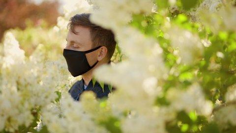 Man in black face mask looks away during virus pandemic