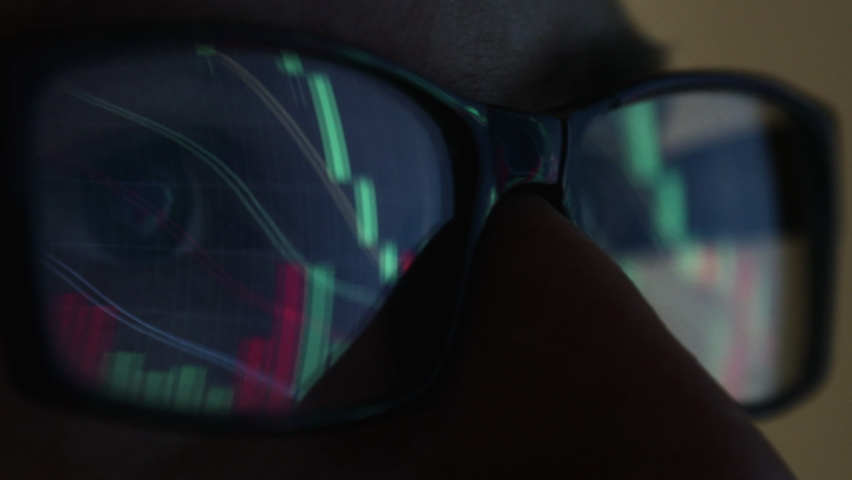 close-up of glasses. Investor watching the change of stock market on laptop screen. Top trader looks at graphs running, Analysing data to make best sell. Full of Screens and Statistics. Royalty-Free Stock Footage #1059772673