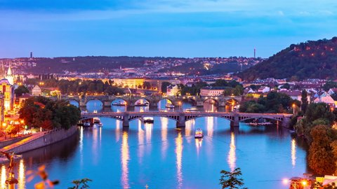PRAGUE, CZECH REPUBLIC - CIRCA AUGUST 2019: Time-lapse view on the sunset over the city and the river Vltava circa August 2019 in Prague, Czech Republic.