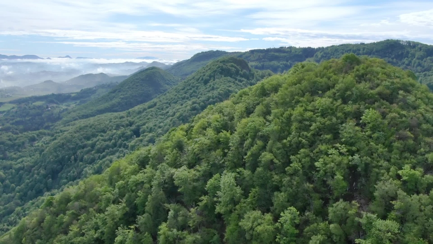 Cinematic aerial shot of an endless mountain and forest landscape in southern Slovenia Royalty-Free Stock Footage #1059788120