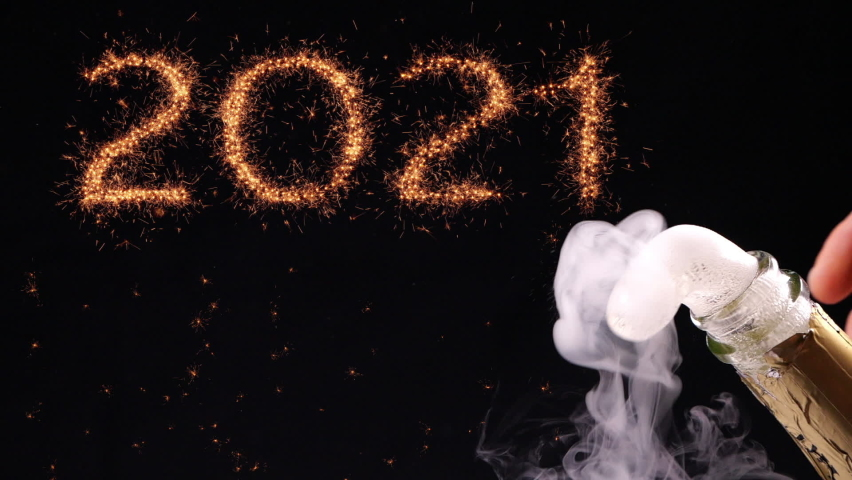 Happy new year celebration concept. Popping a champagne bottle open at new year's eve. Sparklers bursting out forming the year numbers. Royalty-Free Stock Footage #1059812564