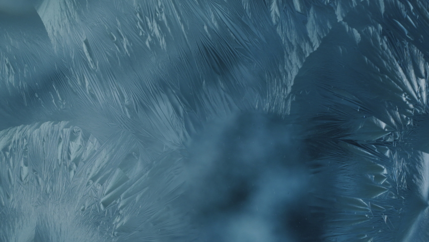 Beautiful ice flowers pattern forming on glass surface, ice flower crystals growth on window, macro | Shutterstock HD Video #1059862610