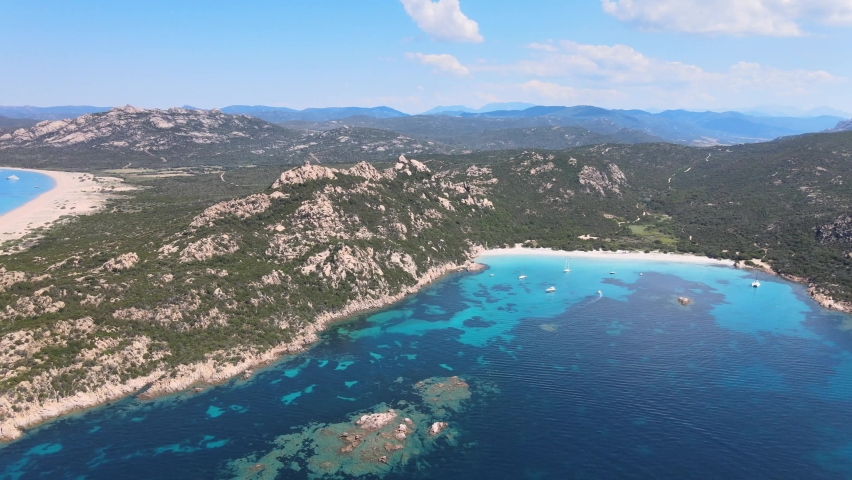 Footage from the drone of two beaches in Corsica seen from the sea with wonderful colors