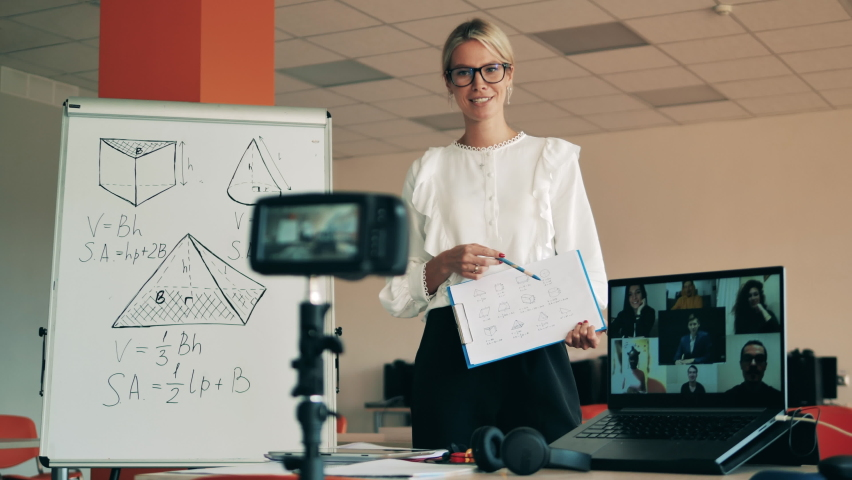 Online class conducted by a female teacher for adults. Remote education, online college lesson, distant studying concept. Royalty-Free Stock Footage #1059870395