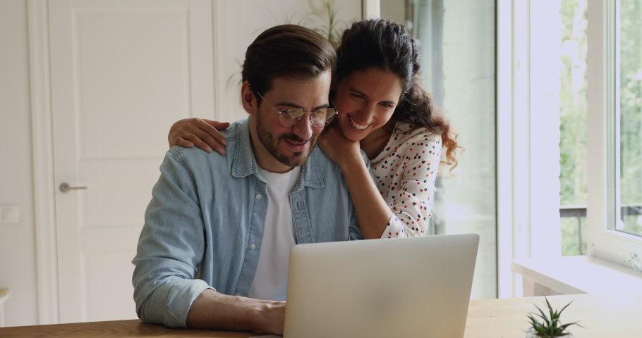 Couple using laptop choose goods buying clothes on-line on webstore, selecting travel tour plan vacation. Shopping together, make easy delivery service at home, comfortable purchasing remotely concept Royalty-Free Stock Footage #1059883115