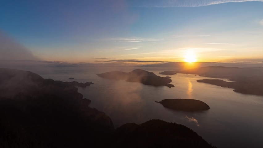 Timelapse. Beautiful View of Canadian Mountain Landscape during a colorful sunny sunset. Taken on St. Mark's Summit, West Vancouver, British Columbia, Canada. Nature Background