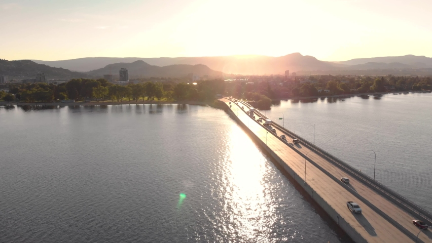 Aerial footage of bridge leading to Downtown Kelowna on Lake Okanagan at sunrise with beautiful light. 4K 24FPS.