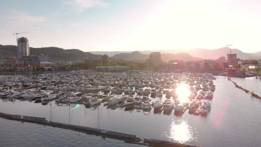 Aerial footage of Downtown Kelowna on Lake Okanagan at sunrise with beautiful light. 4K 24FPS.