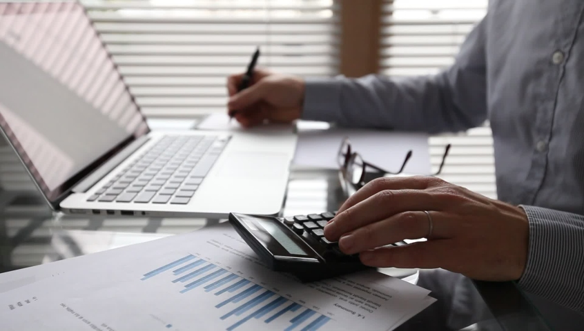 finance and accounting, calculating return on investment, company budget planning Royalty-Free Stock Footage #1059901553