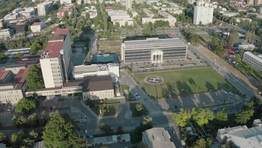 Aerial shot of hospital with helipad | Shutterstock HD Video #1059901706