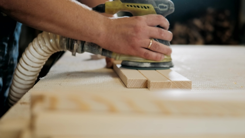 Working process in the carpentry workshop.A man Using Electric Sander for wood in a carpentry workshop.Profession, carpentry, woodwork and people concept   Shutterstock HD Video #1059904796